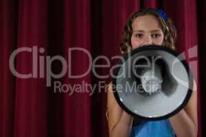 Female artist announcing on megaphone