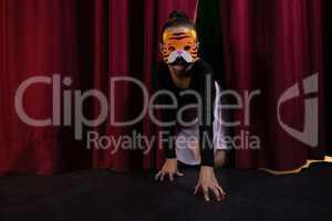 Ballet dancer wearing mask crawling