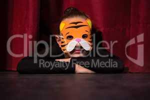 Ballet dancer wearing mask sleeping
