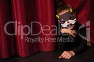 Ballet dancer wearing mask gesturing