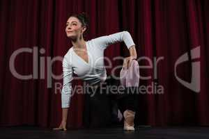 Ballerina performing stretching exercise