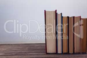 Books arranged on wooden table