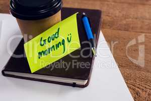 Black coffee with message on desk