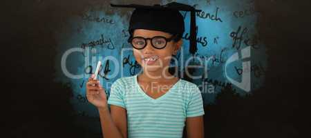 Composite image of portrait of smiling girl wearing mortarboard and holding chalk