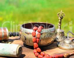 singing bowl with stone rosary