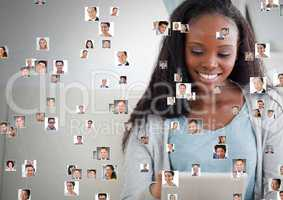 Woman holding tablet with Profile portraits of people contacts