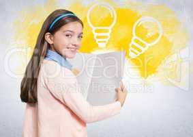 Girl reading book in front of lightbulbs