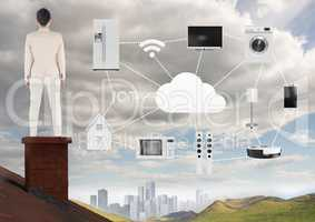 Businesswoman on roof with home object and machines icons over city