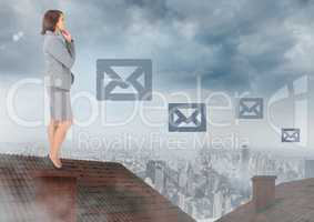 Email icons and Businesswoman standing on Roof with chimney and cloudy city