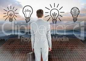 Light bulb idea icons and Businessman standing on Roof with chimney and misty landscape
