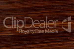 Dark rosewood background, natural wooden texture with patterns.
