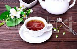 hot black tea in a white cup with a saucer