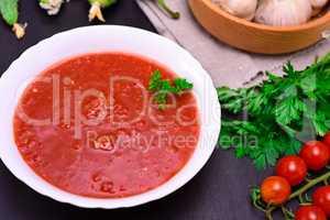 cold tomato soup gazpacho in a round white plate