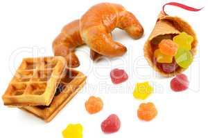 Croissants, waffles and marmalade isolated on white
