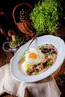 Forest mushroom sauce with fresh mushrooms, potato and poached e