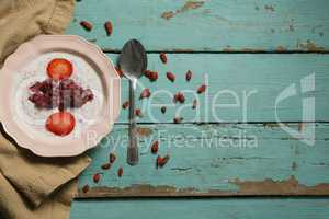 Yogurt and fruits in bowl