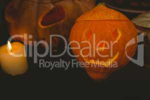 High angle view of illuminated jack o lanterns with candle