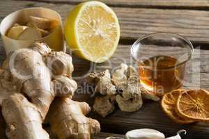 Tea cup with folk medicine on table