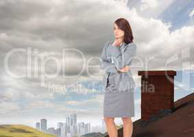 Businesswoman standing on Roof with chimney in country with city in distance