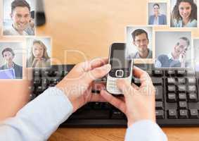 Holding phone with Profile portraits of people contacts