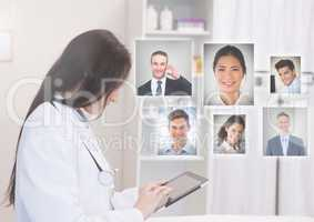 Woman holding laptop with Profile portraits of people contacts