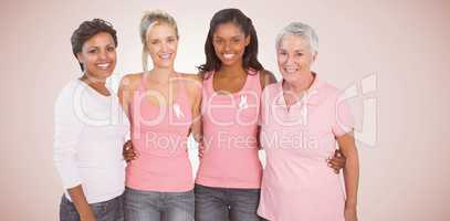 Composite image of portrait of happy women supporting breast cancer social issue