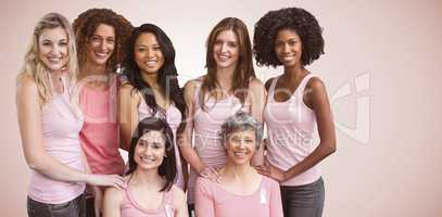 Composite image of smiling women in pink outfits posing for breast cancer awareness