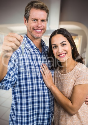 Couple Holding key  in home