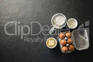 Overhead view of ingredient by egg carton