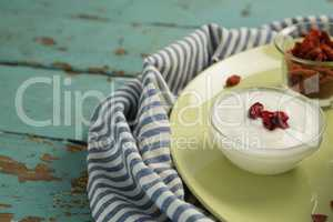 Date palm in yogurt on a wooden table