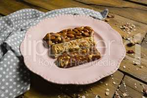 Three dry fruits bars arranged in plate