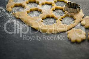 High angle view of flower shape pastry cutter on dough