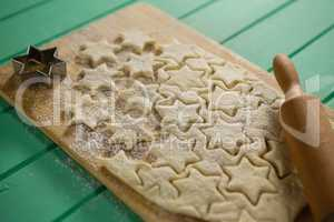Close up of star shape cookies on cutting board