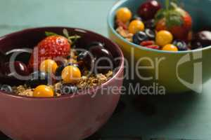 Bowls of breakfast cereals and fruits