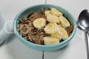 Wheat flakes and banana slice in bowl