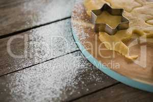 Star shape cutter on pastry dough