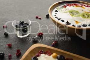 Yogurt and fruits in plate