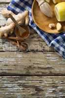 Overhead view of various food with checked napkin on weathered table