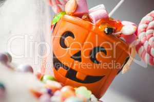 Tilt image of bucket with various sweet food