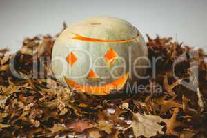 High angle view of illuminated jack o lanterns with autumn leaves