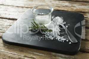 Salt in glass bowl and rosemary herb
