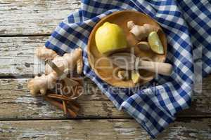 Directly above view of various food with checked napkin on table