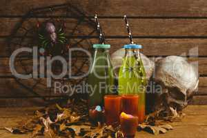 Drinks with decorations and autumn leaves on table