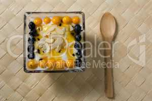 Yogurt with blueberries and golden berries in bowl