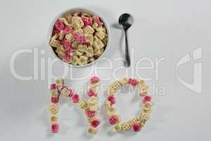 Honeycomb cereal arranged text no with bowl and spoon