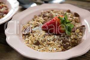 Muesli and strawberry in bowl
