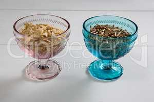 Wheat flakes and cereal bran sticks in bowl