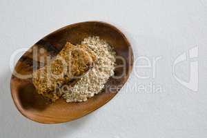 Granola bar and oatmeal in bowl