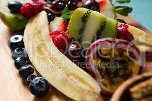 Slice of various fruits in tray