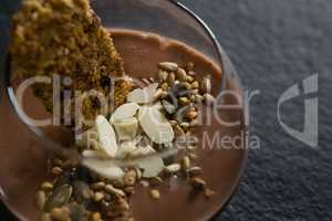 Granola, dried fruits and chocolate mousse in glass